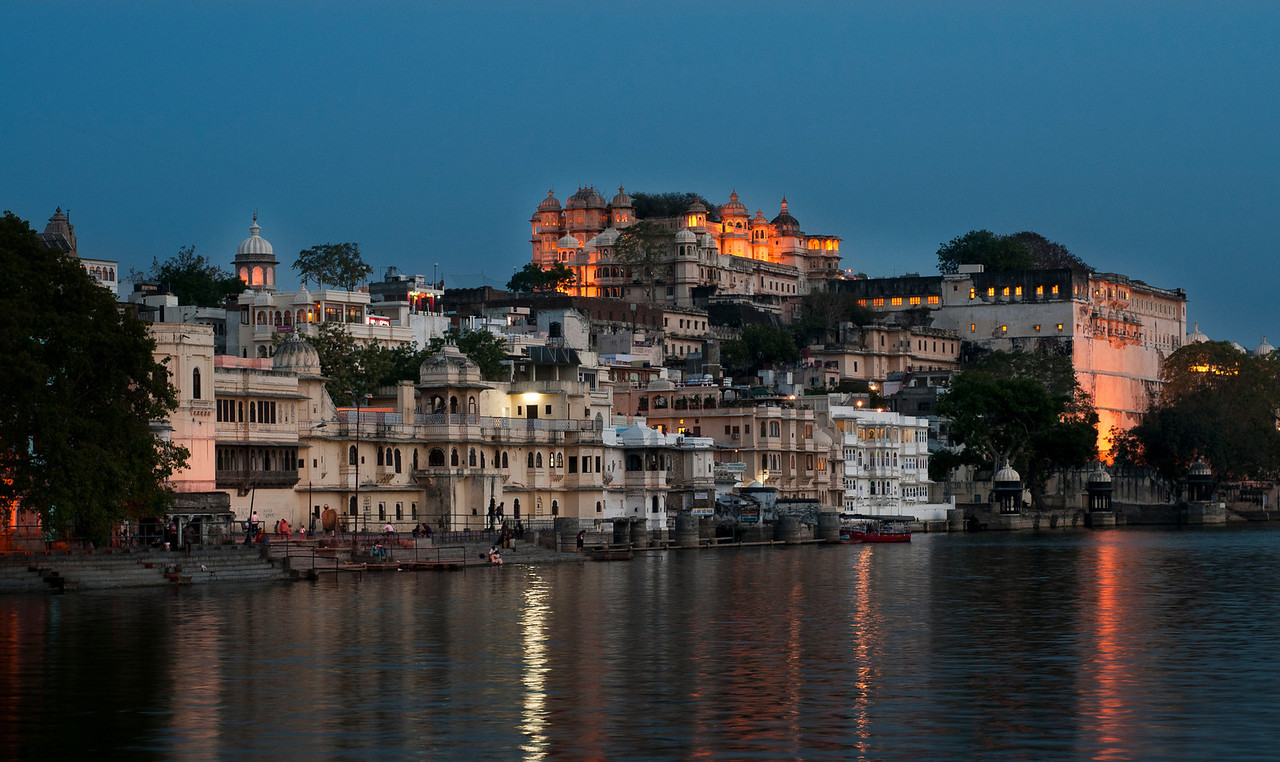 Lake Pichola at night.<br /> Lake Pichola, situated in Udaipur city in the Indian state of Rajasthan, is an artificial fresh water lake, created in the year 1362 AD, named after the nearby Picholi village. It is one of the several contiguous lakes, and developed over the last few centuries in and around the famous Udaipur city. The lakes around Udaipur were primarily created by building dams to meet the drinking water and irrigation needs of the city and its neighborhood. Two islands, Jag Niwas and Jag Mandir are located within Pichola Lake, and have been developed with several palaces to provide views of the lake.<br /> <br /> Udaipur, Rajasthan, India, 2011.