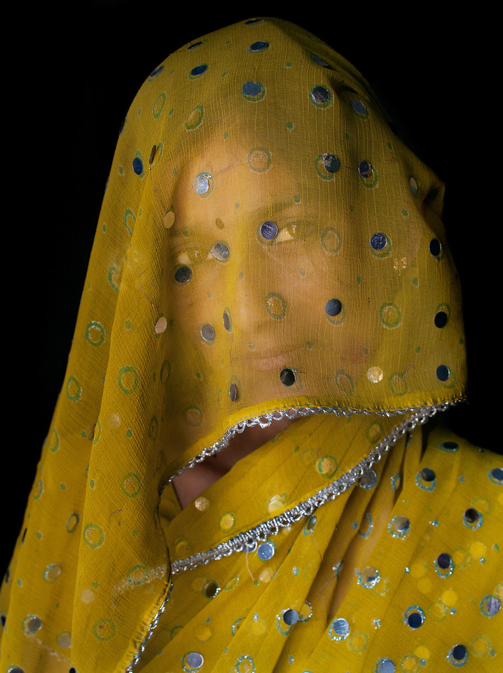 Portrait of a Rajashtani woman taken in a small village outside Udaipur.<br /> <br /> Rajasthan, India, 2011.