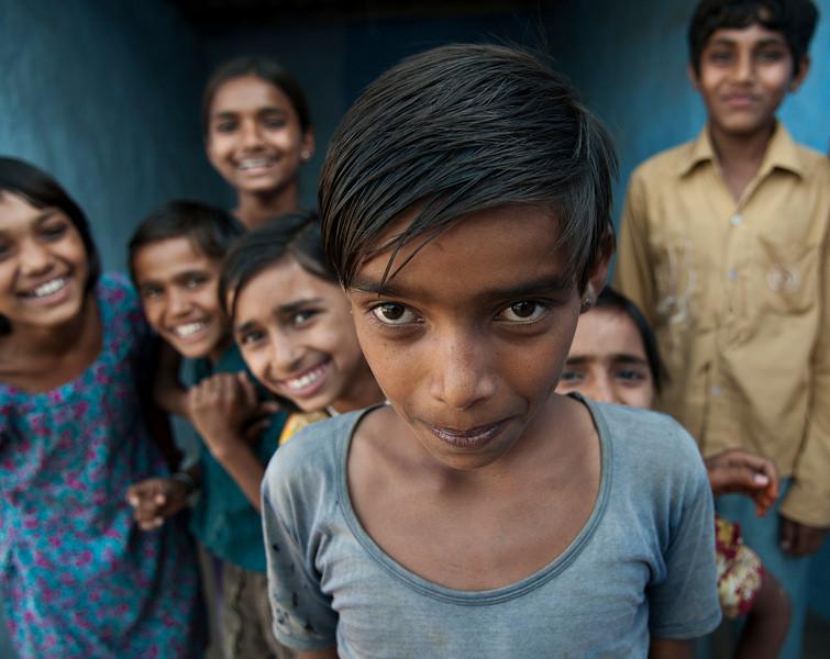 Curious children in a small village near Jaisalmer.<br /> <br /> Rajasthan, India, 2011.
