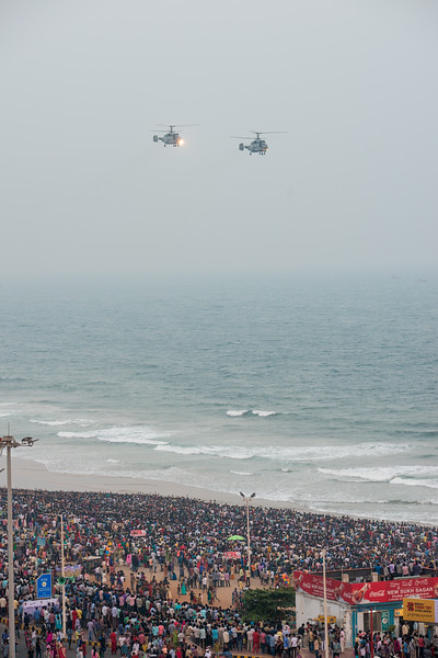 Naval helicopters on display. The Eastern Naval Command, Visakhapatnam celebrated the Navy Day on December 4, marking the day Indian Navy Missile Boats carried out a deadly attack on Karachi Harbour in the 1971 Indo-Pak war.<br /> <br /> Public could view from RK Beach, the manoeuvres by Destroyers, Corvettes, fast attack craft and Landing Ships, beach assault by Marine Commandos, Sky Diving, close range anti-aircraft firing, band performance, formation anchoring, and a host of other exercises. A total of 17 ships, 13 aircraft, and a submarine took part in the grand display and demonstration.  Visakhapatnam (Vizag), Andhra Pradesh, India.