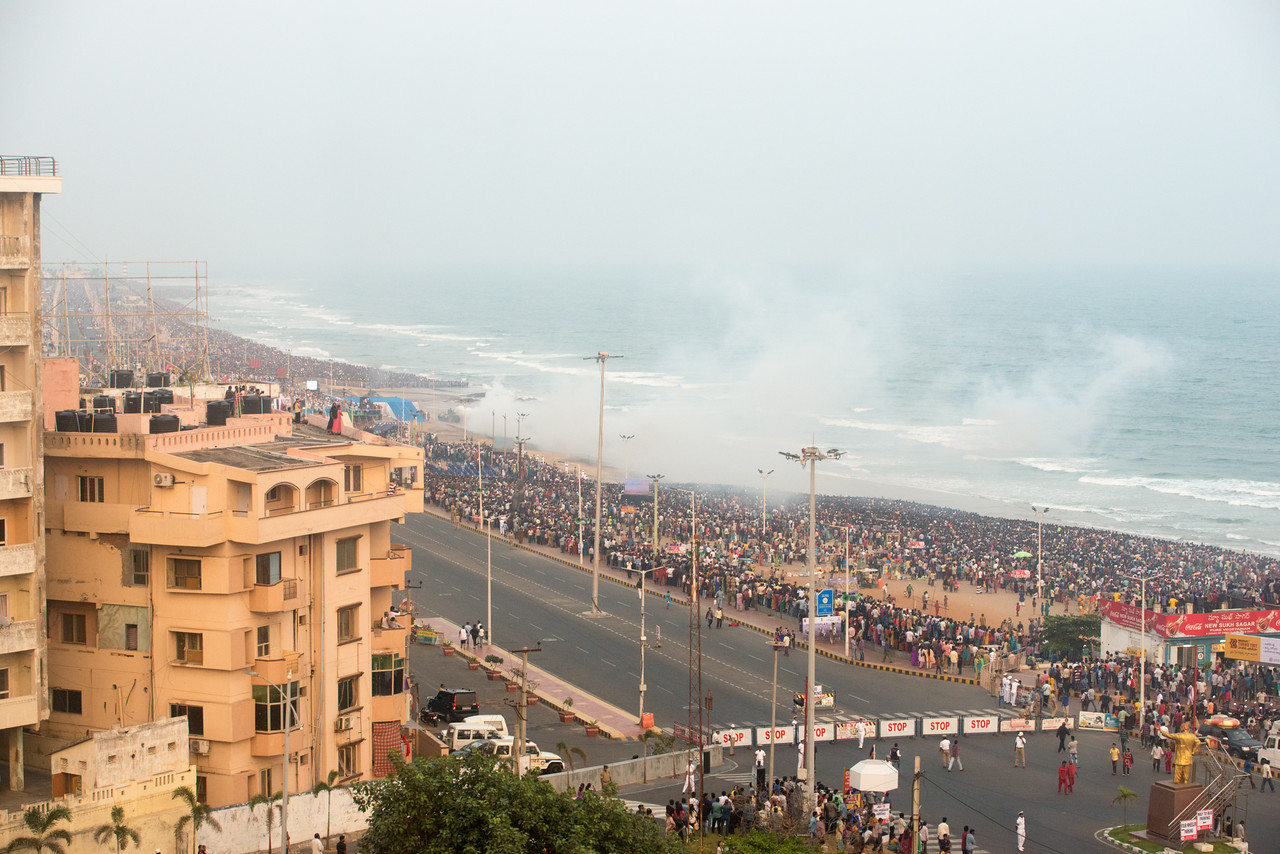 Huge crowds watching Navy Day celebrations. The Eastern Naval Command, Visakhapatnam celebrated the Navy Day on December 4, marking the day Indian Navy Missile Boats carried out a deadly attack on Karachi Harbour in the 1971 Indo-Pak war.<br /> <br /> Public could view from RK Beach, the manoeuvres by Destroyers, Corvettes, fast attack craft and Landing Ships, beach assault by Marine Commandos, Sky Diving, close range anti-aircraft firing, band performance, formation anchoring, and a host of other exercises. A total of 17 ships, 13 aircraft, and a submarine took part in the grand display and demonstration.  Visakhapatnam (Vizag), Andhra Pradesh, India.
