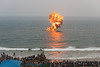 Explosions simulate an attack and defence. The Eastern Naval Command, Visakhapatnam celebrated the Navy Day on December 4, marking the day Indian Navy Missile Boats carried out a deadly attack on Karachi Harbour in the 1971 Indo-Pak war.<br /> <br /> Public could view from RK Beach, the manoeuvres by Destroyers, Corvettes, fast attack craft and Landing Ships, beach assault by Marine Commandos, Sky Diving, close range anti-aircraft firing, band performance, formation anchoring, and a host of other exercises. A total of 17 ships, 13 aircraft, and a submarine took part in the grand display and demonstration.  Visakhapatnam (Vizag), Andhra Pradesh, India.