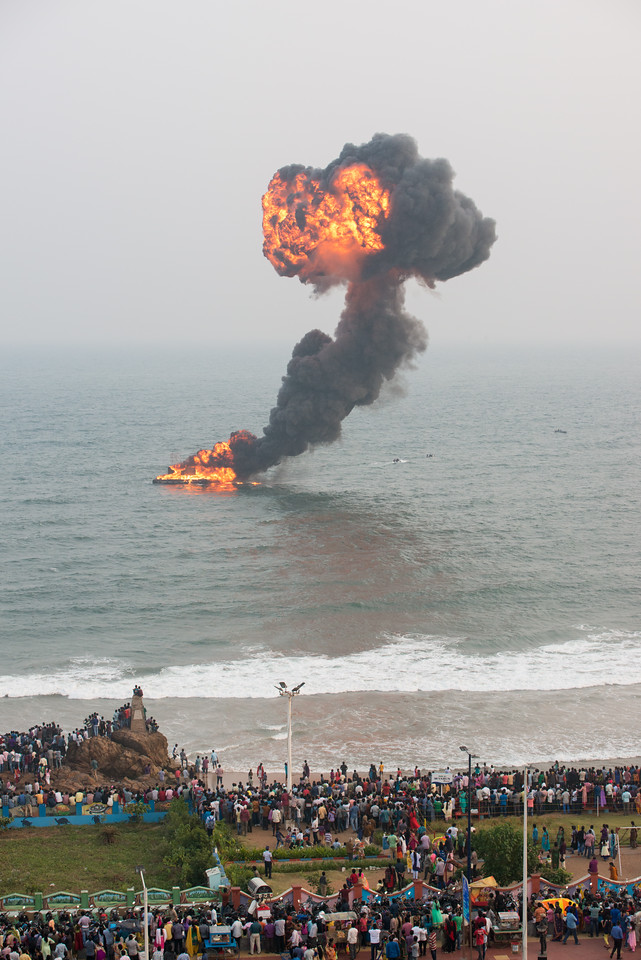 Comandos move in on a simulated exercise at the Ramakrishna beach. The Eastern Naval Command, Visakhapatnam celebrated the Navy Day on December 4, marking the day Indian Navy Missile Boats carried out a deadly attack on Karachi Harbour in the 1971 Indo-Pak war.<br /> <br /> Public could view from RK Beach, the manoeuvres by Destroyers, Corvettes, fast attack craft and Landing Ships, beach assault by Marine Commandos, Sky Diving, close range anti-aircraft firing, band performance, formation anchoring, and a host of other exercises. A total of 17 ships, 13 aircraft, and a submarine took part in the grand display and demonstration.  Visakhapatnam (Vizag), Andhra Pradesh, India.