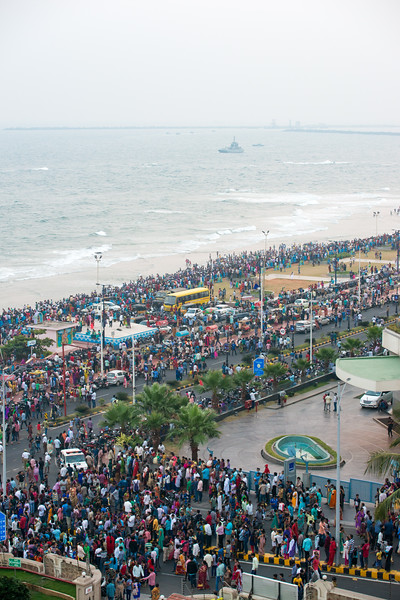 View of the crowds on Ramakrishna Beach from The Gateway Hotel Beach Road Visakhapatnam. The Eastern Naval Command, Visakhapatnam celebrated the Navy Day on December 4, marking the day Indian Navy Missile Boats carried out a deadly attack on Karachi Harbour in the 1971 Indo-Pak war.<br /> <br /> Public could view from RK Beach, the manoeuvres by Destroyers, Corvettes, fast attack craft and Landing Ships, beach assault by Marine Commandos, Sky Diving, close range anti-aircraft firing, band performance, formation anchoring, and a host of other exercises. A total of 17 ships, 13 aircraft, and a submarine took part in the grand display and demonstration.  Visakhapatnam (Vizag), Andhra Pradesh, India.