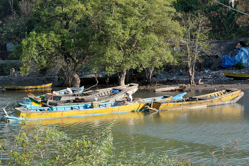 Local fishermen tending to their boats and nets at the beach at Port Blair, A&N (Andaman & Nicobar) Islands.