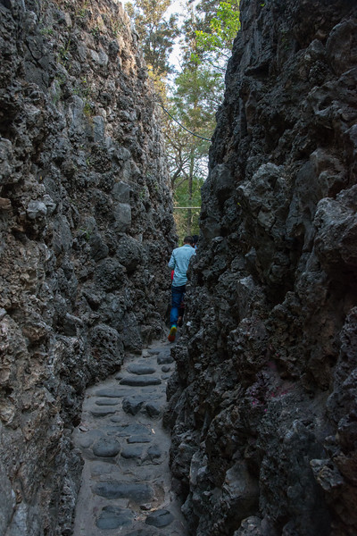 Narrow cobbled pathways at the Rock Garden. The Rock Garden of Chandigarh (also known as Nek Chand's Rock Garden after its founder) is a sculpture garden in Chandigarh, India. Nek Chand was a government official who started the garden secretly in his spare time in 1957. Today it is spread over an area of 40 acres and is completely built of industrial and home waste and thrown-away items. The Rock Garden, is one of the most famous sites in India. Nek Chand, the creator of this place, died in 2015 but his site is visited by millions of people every year.