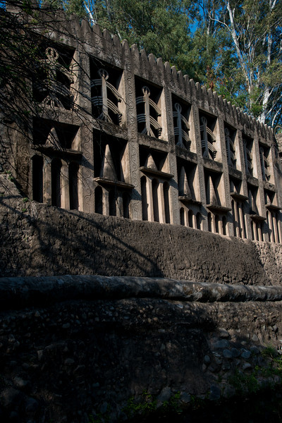 Decorated wall at Rock Garden. The Rock Garden of Chandigarh (also known as Nek Chand's Rock Garden after its founder) is a sculpture garden in Chandigarh, India. Nek Chand was a government official who started the garden secretly in his spare time in 1957. Today it is spread over an area of 40 acres and is completely built of industrial and home waste and thrown-away items. The Rock Garden, is one of the most famous sites in India. Nek Chand, the creator of this place, died in 2015 but his site is visited by millions of people every year.