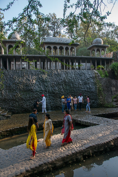 Many visitors come see The Rock Garden often climbing and not heeding to the signs.<br /> <br /> The Rock Garden of Chandigarh (also known as Nek Chand's Rock Garden after its founder) is a sculpture garden in Chandigarh, India. Nek Chand was a government official who started the garden secretly in his spare time in 1957. Today it is spread over an area of 40 acres and is completely built of industrial and home waste and thrown-away items. The Rock Garden, is one of the most famous sites in India. Nek Chand, the creator of this place, died in 2015 but his site is visited by millions of people every year.