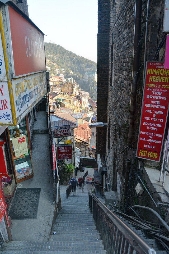 Narrow streets in Shimla. Shimla is the capital city of the Indian state of Himachal Pradesh, located in northern India at an elevation of 7,200 ft. Due to its weather and view it attracts many tourists. It is also the former capital of the British Raj.