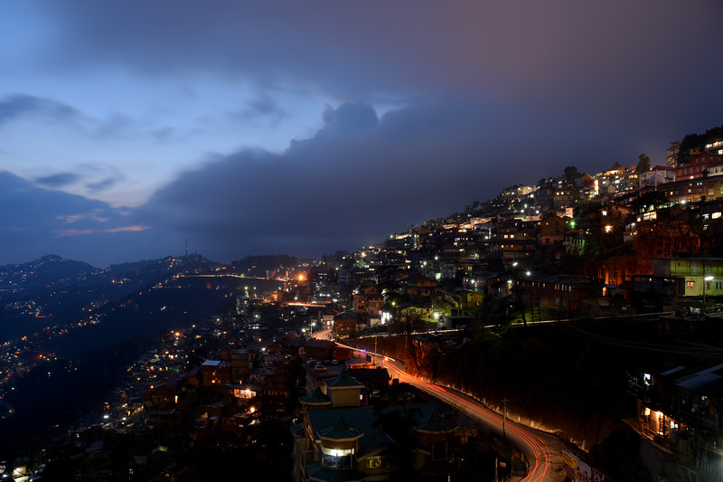 Night view of Shimla. Shimla is the capital city of the Indian state of Himachal Pradesh, located in northern India at an elevation of 7,200 ft. Due to its weather and view it attracts many tourists. It is also the former capital of the British Raj.