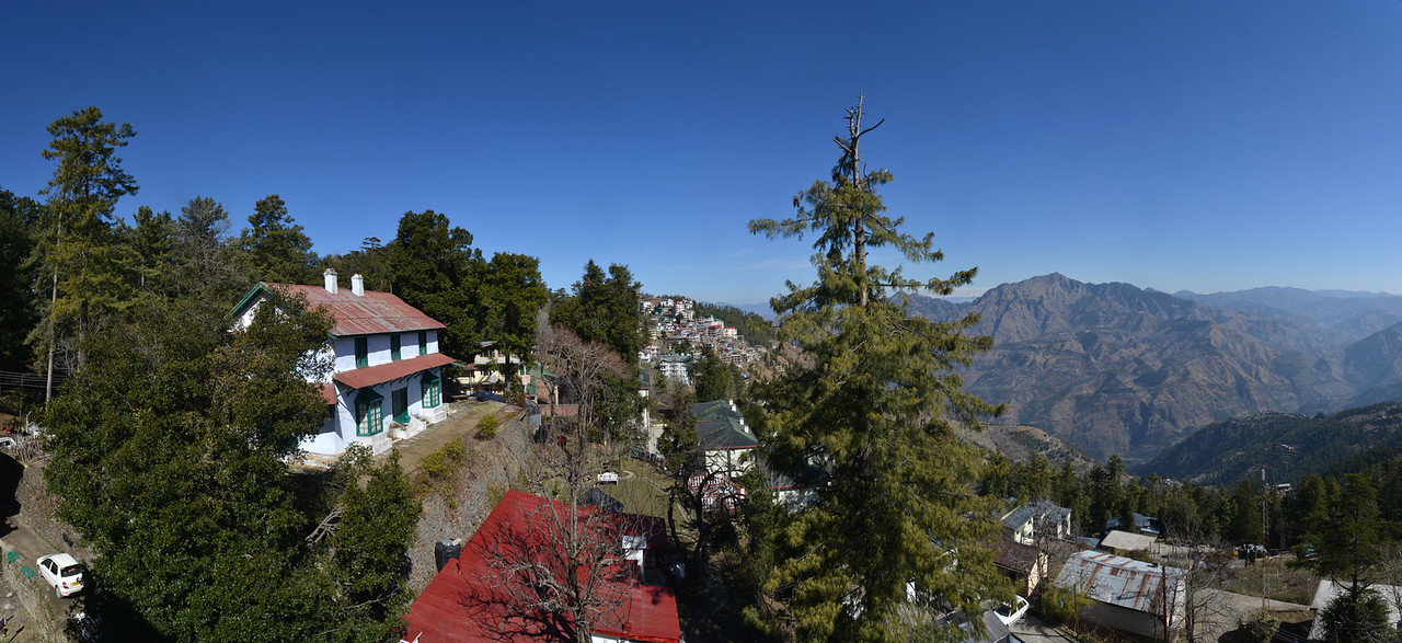 Clear blue sky and a lovely panoramic view of Shimla. Shimla is the capital city of the Indian state of Himachal Pradesh, located in northern India at an elevation of 7,200 ft. Due to its weather and view it attracts many tourists. It is also the former capital of the British Raj.