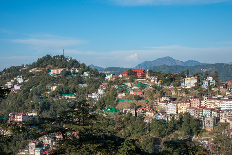 View of the slopes of Shimla, Himachal Pradesh, India. Shimla is the capital city of the Indian state of Himachal Pradesh, located in northern India at an elevation of 7,200 ft. Due to its weather and view it attracts many tourists. It is also the former capital of the British Raj.