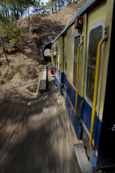 The Kalka–Shimla Railway was included in the UNESCO World Heritage List as part of the World Heritage Site Mountain Railways of India. The route from Kalka to Shimla involves journey through 103 tunnels and 864 bridges. Shimla is the capital city of the Indian state of Himachal Pradesh, located in northern India at an elevation of 7,200 ft. Due to its weather and view it attracts many tourists who arrive on the narrow gauge train.