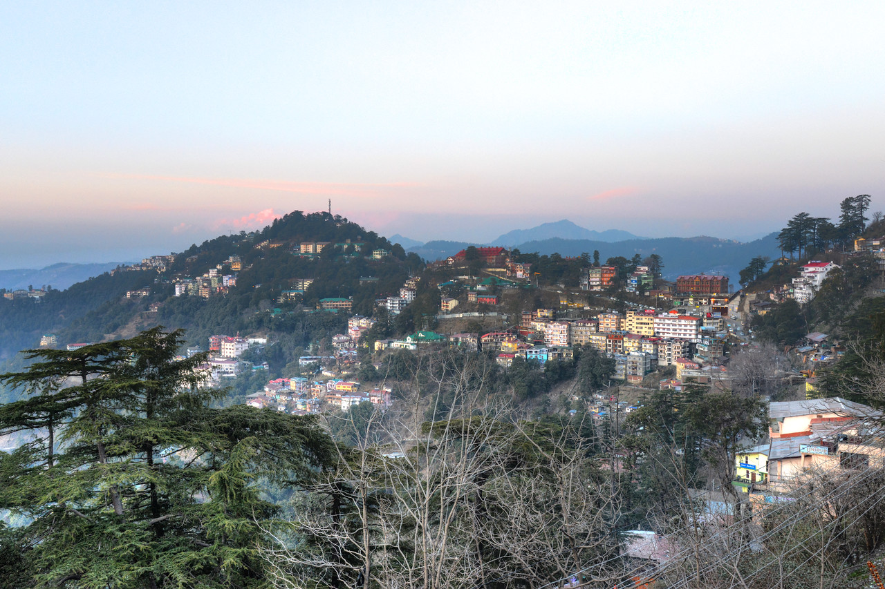 Beautiful view from The Mall Road, Shimla.<br /> Shimla is the capital city of the Indian state of Himachal Pradesh, located in northern India at an elevation of 7,200 ft. Due to its weather and view it attracts many tourists. It is also the former capital of the British Raj.