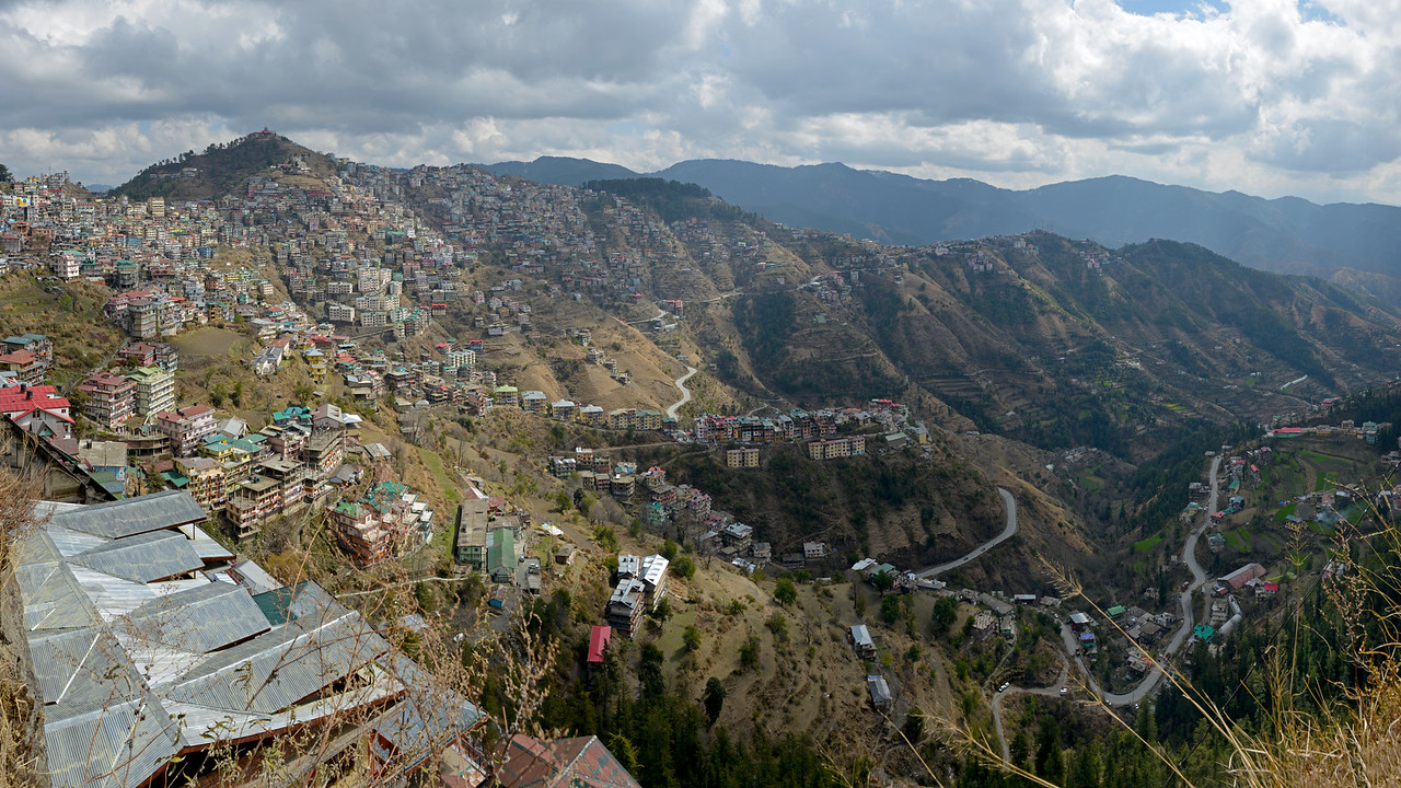 Panoramic view of Shimla. Shimla is the capital city of the Indian state of Himachal Pradesh, located in northern India at an elevation of 7,200 ft. Due to its weather and view it attracts many tourists. It is also the former capital of the British Raj.