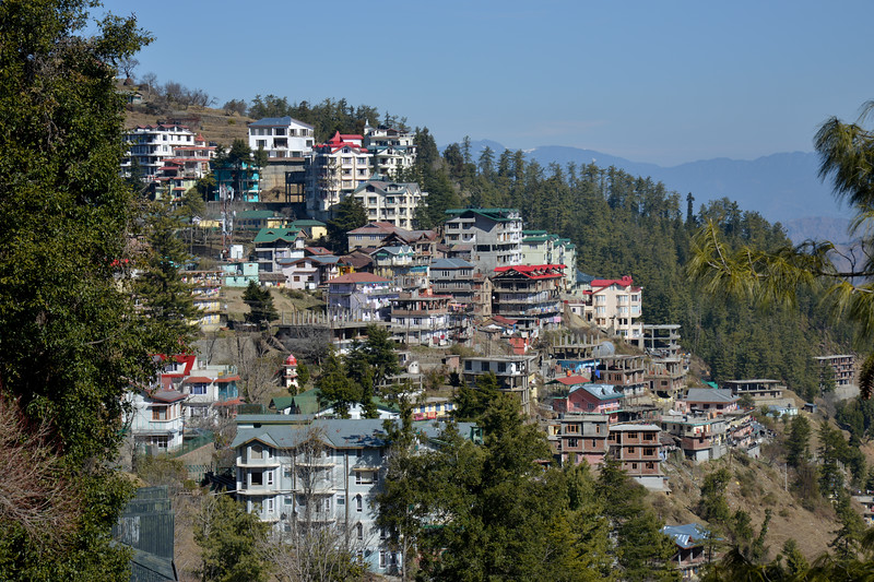 Driving near Mashobra. Shimla is the capital city of the Indian state of Himachal Pradesh, located in northern India at an elevation of 7,200 ft. Due to its weather and view it attracts many tourists. It is also the former capital of the British Raj.