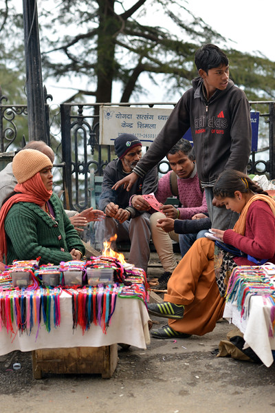 Warming the hands on a fire. Shimla is the capital city of the Indian state of Himachal Pradesh, located in northern India at an elevation of 7,200 ft. Due to its weather and view it attracts many tourists. It is also the former capital of the British Raj.