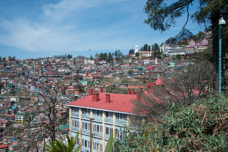 The Mall Road, Shimla from outside Clarkes Hotel Shimla, Himachal Pradesh, India. Shimla is the capital city of the Indian state of Himachal Pradesh, located in northern India at an elevation of 7,200 ft. Due to its weather and view it attracts many tourists. It is also the former capital of the British Raj.