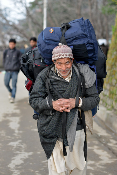 Very heavy loads are carried on the back by porters on hire. Shimla is the capital city of the Indian state of Himachal Pradesh, located in northern India at an elevation of 7,200 ft. Due to its weather and view it attracts many tourists. It is also the former capital of the British Raj.