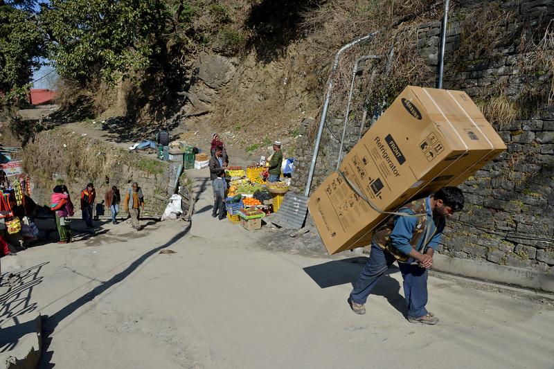 People of the hills carry lots of weight. This man is carrying a Samsung refrigerator on his back.<br /> Shimla is the capital city of the Indian state of Himachal Pradesh, located in northern India at an elevation of 7,200 ft. Due to its weather and view it attracts many tourists. It is also the former capital of the British Raj.