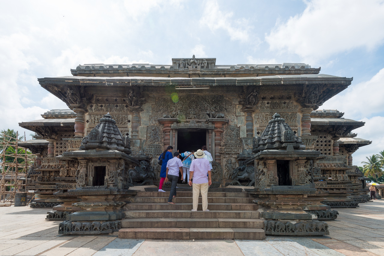 Visitors to Channakesava Temple. The Channakesava Temple, Belur, Karnataka. Originally called Vijayanarayana Temple, it was built on the banks of the Yagachi River in Belur, Hassan district by the Hoysala Empire King Vishnuvardhana.<br /> <br /> Channakesava is a form of the Hindu god Vishnu. Belur is famous for its marvelous temples and have been proposed to be listed under UNESCO World Heritage Sites.