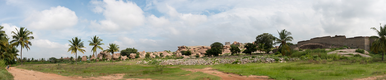 Panoramic view of Hampi near Lakshmi Narasimha temple. Hampi, Karnataka is a world famous UNESCO World Heritage Site. Hampi was one of the largest and richest city in the world during its prime time when it was the imperial capital of the Vijayanagara Empire in the 14th century. Today it continues to be an important religious centre, housing temples and several other monuments belonging to the old city.