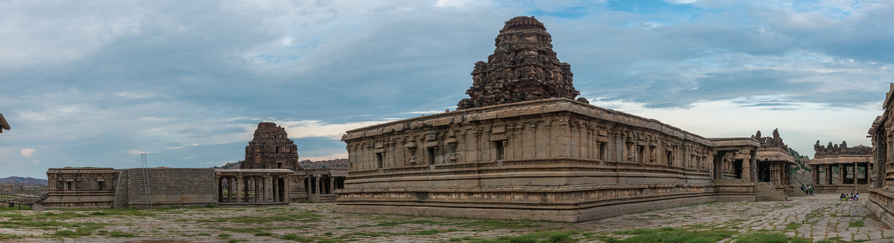 Panoramic view of the Vittala Temple. The temple is built in the form of a sprawling campus with compound wall and gateway towers. There are many halls, pavilions and temples located inside this campus.<br /> <br /> Vittala, after whom the temple is known, is a form of Lord Vishnu. Hampi, Karnataka is a world famous UNESCO World Heritage Site.