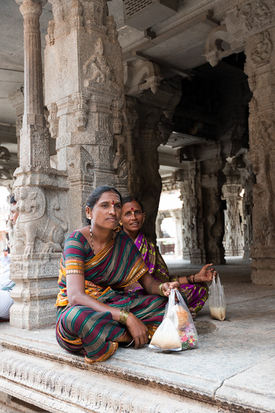 Visitors and pilgrims at Virupaksha temple. Virupaksha temple is the oldest and the principal temple in Hampi. This Lord Shiva temple is easily one of the oldest functioning temple in India and is located on the south bank of the river Tungabadra in Karnataka.