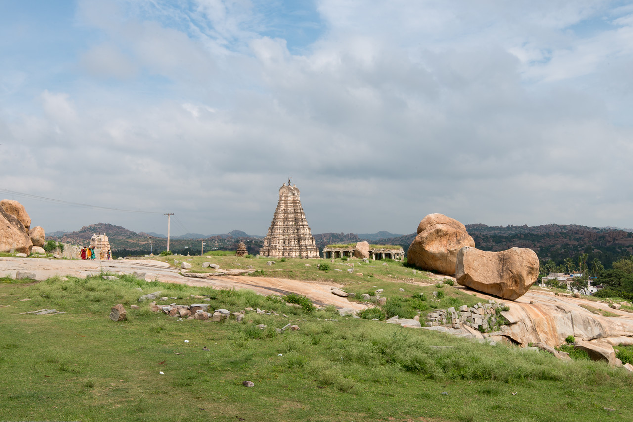 View from Ganesha temple. Kadalekalu Ganesha - giant statue of Ganesha was carved out of a huge boulder at the northeastern slope of the Hemakuta hill. The belly of this statue resembles a Bengal gram (Kadalekalu, in local language) and hence the name.