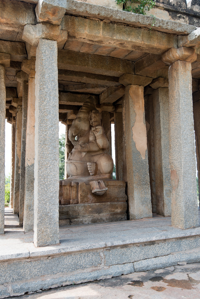 Sasivekalu Ganesha Temple, a giant monolithic statue of Lord Ganesha, is one of the popular attractions in Hampi. The statue is 2.4 metres (8 feet) tall. <br /> The history of the statue of Sasivekalu Ganesha dates back to the 16th century. The statue is in a sitting position (half-lotus posture) and has four arms. The upper right hand of the statue has a goad while the lower right hand holds the broken tusk.