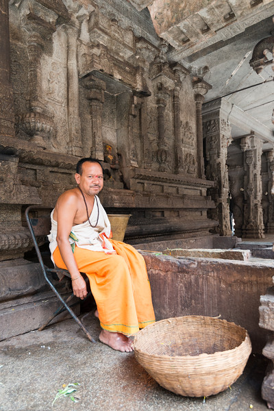 Pujari (priest) at the Virupaksha temple. <br /> <br /> Virupaksha temple is the oldest and the principal temple in Hampi. This Lord Shiva temple is easily one of the oldest functioning temple in India and is located on the south bank of the river Tungabadra.