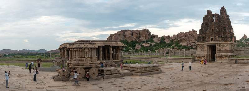 Panoramic Vittala Temple view. Vittala Temple is the most extravagant architectural showpiece of Hampi. The temple is built in the form of a sprawling campus with compound wall and gateway towers. There are many halls, pavilions and temples located inside this campus. Vittala, after whom the temple is known, is a form of Lord Vishnu. The temple was originally built in the 15th century AD. Many successive kings have enhanced the temple campus during their regimes to the present form.