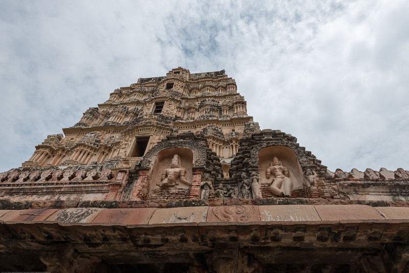 Virupaksha temple is the oldest and the principal temple in Hampi. This Lord Shiva temple is easily one of the oldest functioning temple in India and is located on the south bank of the river Tungabadra.