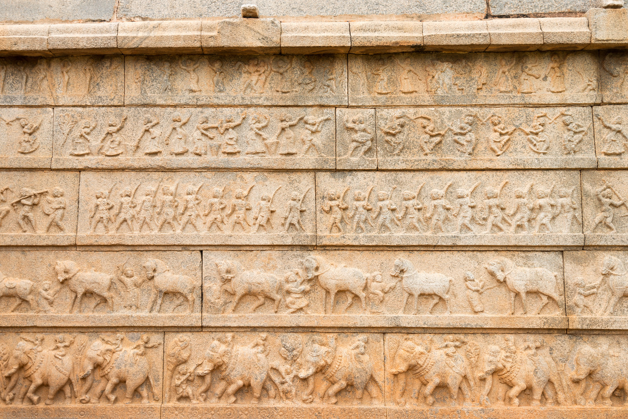 Carvings on the exterior walls. Hazara Rama (a thousand Rama) Temple owing to this multitude of these Ramayana panels on its walls. Epic Ramayana stories are carved in long arrays onto the walls of this temple.<br /> <br /> Hampi, Karnataka is a world famous UNESCO World Heritage Site. Hampi was one of the largest and richest city in the world during its prime time when it was the imperial capital of the Vijayanagara Empire in the 14th century. Today it continues to be an important religious centre, housing temples and several other monuments belonging to the old city.
