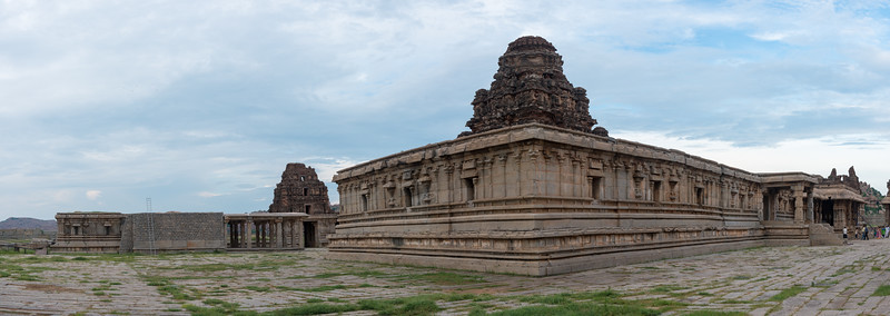 Panoramic view of the Vittala Temple. Vittala Temple is the most extravagant architectural showpiece of Hampi. The temple is built in the form of a sprawling campus with compound wall and gateway towers. There are many halls, pavilions and temples located inside this campus. Vittala, after whom the temple is known, is a form of Lord Vishnu. The temple was originally built in the 15th century AD. Many successive kings have enhanced the temple campus during their regimes to the present form. Hampi, Karnataka is a world famous UNESCO World Heritage Site.