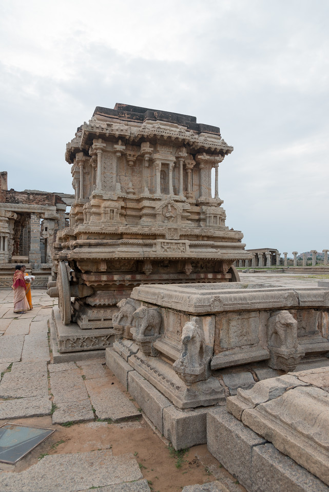 Vittala Temple is the most extravagant architectural showpiece of Hampi. The temple is built in the form of a sprawling campus with compound wall and gateway towers. There are many halls, pavilions and temples located inside this campus.<br /> <br /> Vittala, after whom the temple is known, is a form of Lord Vishnu. The temple was originally built in the 15th century AD. Many successive kings have enhanced the temple campus during their regimes to the present form. Hampi, Karnataka is a world famous UNESCO World Heritage Site.