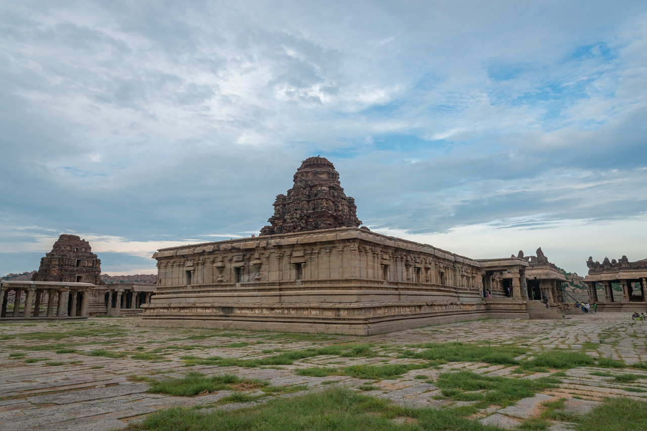 Vittala Temple is the most extravagant architectural showpiece of Hampi. The temple is built in the form of a sprawling campus with compound wall and gateway towers. There are many halls, pavilions and temples located inside this campus.<br /> <br /> Vittala, after whom the temple is known, is a form of Lord Vishnu. The temple was originally built in the 15th century AD. Many successive kings have enhanced the temple campus during their regimes to the present form.