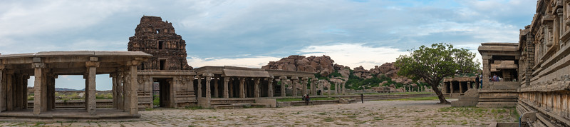 Panoramic view of the Vittala Temple. Vittala Temple is the most extravagant architectural showpiece of Hampi. The temple is built in the form of a sprawling campus with compound wall and gateway towers. There are many halls, pavilions and temples located inside this campus.<br /> <br /> Vittala, after whom the temple is known, is a form of Lord Vishnu. The temple was originally built in the 15th century AD. Many successive kings have enhanced the temple campus during their regimes to the present form.