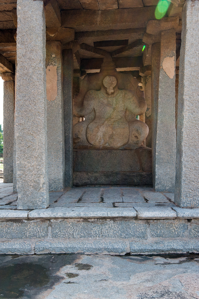 Sasivekalu Ganesha Temple, a giant monolithic statue of Lord Ganesha in Hampi. The statue is 2.4 metres (8 feet) tall. The statue  was constructed by a merchant from Chandragiri (a place in present day Andhra Pradesh) in memory of the then king of Vijayanagara, Narasimha II (1491 – 1505 AD).<br /> <br /> The statue is in a sitting position (half-lotus posture) and has four arms. The upper right hand of the statue has a goad while the lower right hand holds the broken tusk.