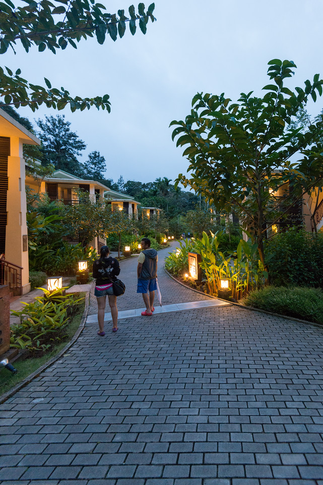 Strolling after sundown at the resort. Club Mahindra Virajpet, Coorg-Virajpet quaint retreat in Kodagu Valley.<br /> <br /> Named after the former ruler of Kodagu, Virarajendra, Virajpet is an abbreviation for Virarajendrapete. Virajpet is a small town known for the local coffee and spice crops. Virajpet. This is a large and beautiful resort surrounded by nature.