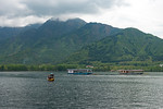 Dal Lake view from the floating house boats on Dal Lake, Srinagar, Jammu and Kashmir, India.  They are usually moored at the edges of the Dal Lake and Nageen lakes. Some were built in the ea ...