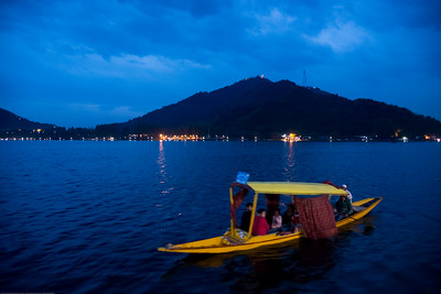"""Dal Lake, Jammu and Kashmir, India.  Dal is a lake in Srinagar (Dal Lake is a misnomer as Dal in Kashmiri means lake), the summer capital of the Indian state of Jammu and Kashmir. The urban lake, is the second largest in the state, is integral to tourism and recreation in Kashmir and is named the """"Jewel in the crown of Kashmir"""" or """"Srinagar's Jewel""""."""