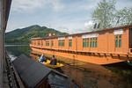 Shikaras ferry on Dal Lake between floating house boats. oDal Lake, Srinagar, Jammu and Kashmir, India.  They are usually moored at the edges of the Dal Lake and Nageen lakes. Some were buil ...
