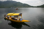 Shikaras come to the floating house boats on Dal Lake, Srinagar, Jammu and Kashmir, India and sell everything from photography rolls/chips to food to flowers and gift items.  They are usuall ...