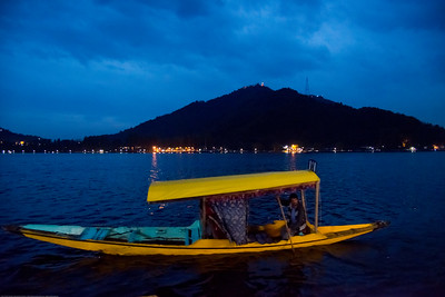 "Dal Lake, Jammu and Kashmir, India. The urban lake, is the second largest in the state, is integral to tourism and recreation in Kashmir and is named the ""Jewel in the crown of Kashmir"" or ""Srinagar's Jewel"". Shikaras ferry people on the lake."