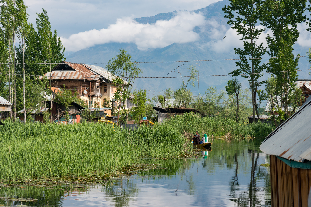 Residents use shikaras (boats) near the floating house boats on Dal Lake, Srinagar, Jammu and Kashmir, India.<br /> <br /> House boats are usually moored at the edges of the Dal Lake and Nageen lakes. Some were built in the early 1900s, and are still being rented out to tourists.
