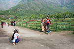 Visitors take pictures in front of the tulips at the Tulip Garden, Jammu and Kashmir, India. Asia?s Largest, with 20 lakh tulips of 46 varieties spread over 30 hectares in the foothills of ...
