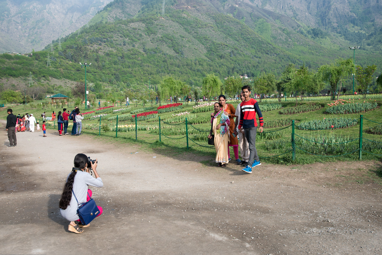 Visitors take pictures in front of the tulips at the Tulip Garden, Jammu and Kashmir, India. Asia's Largest, with 20 lakh tulips of 46 varieties spread over 30 hectares in the foothills of the snow-clad Zabarwan range.