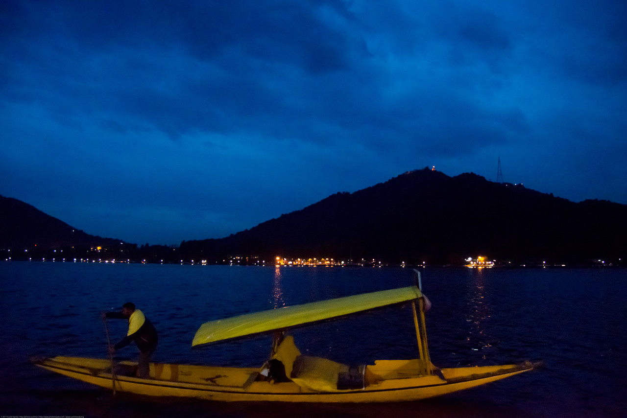 """Dal Lake, Jammu and Kashmir, India. The urban lake, is the second largest in the state, is integral to tourism and recreation in Kashmir and is named the """"Jewel in the crown of Kashmir"""" or """"Srinagar's Jewel"""". Shikaras ferry people on the lake."""