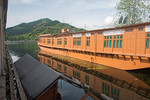 View from our room on the floating house boats on Dal Lake, Srinagar, Jammu and Kashmir, India.  They are usually moored at the edges of the Dal Lake and Nageen lakes. A luxury houseboat, li ...